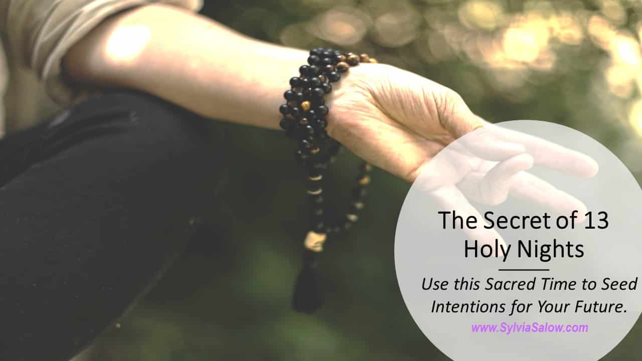 woman meditating in nature with mala beads necklace
